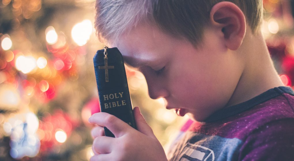 Kid Holding the Bible