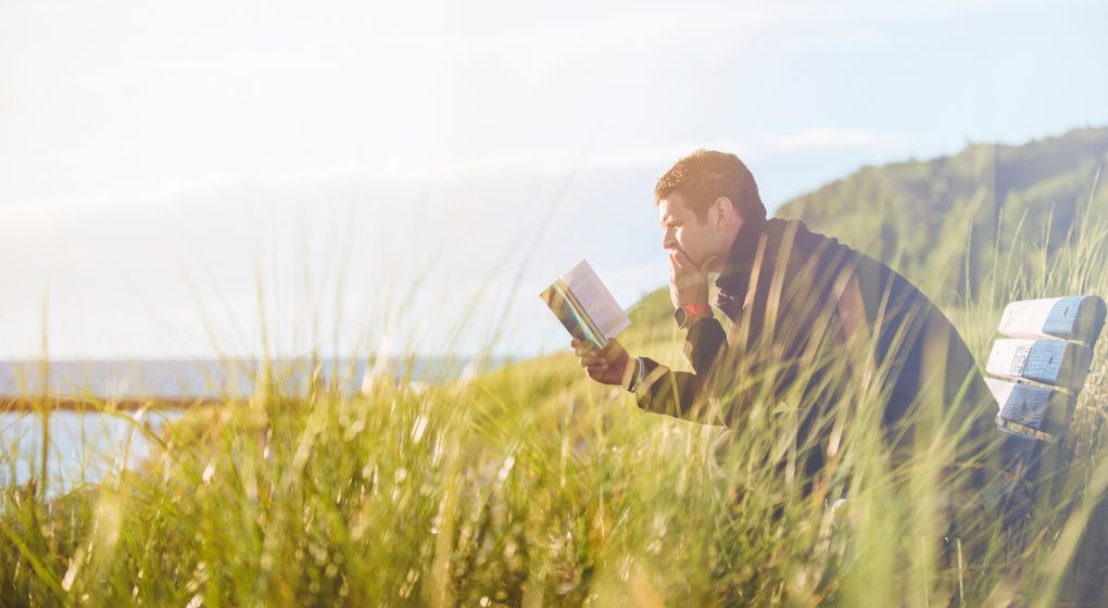 Image of Man Reading Bible - trust in the Lord